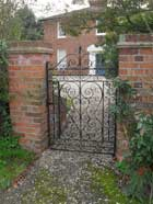 hand scrolled/clipped entrance gate