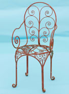 very pretty / fancy chair with lots of hand forged scrolls
