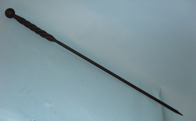 Long, heavy poker with hand forged twisted handle and ball top