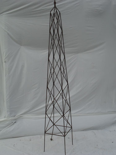 Tall obelisk with cast finial