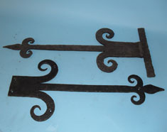 Door bracket (either real or dummy hinger) with hand forged scrolls