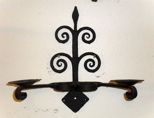 Double wall light / candle holder with hand forged scrolls and mottled forge finish
