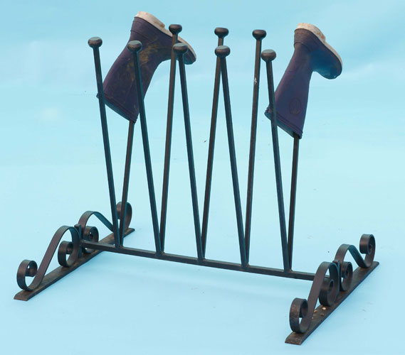 Fancy boot stand with hand forged scrolls