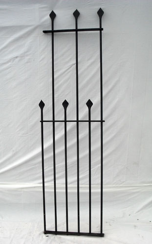 Tall railings with hand forged spears