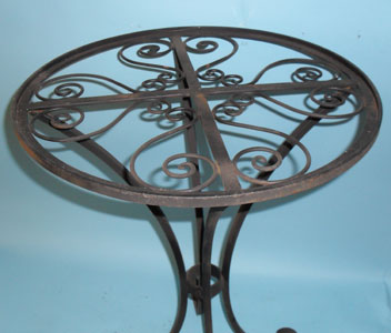 Small round table with scrolled top and feet