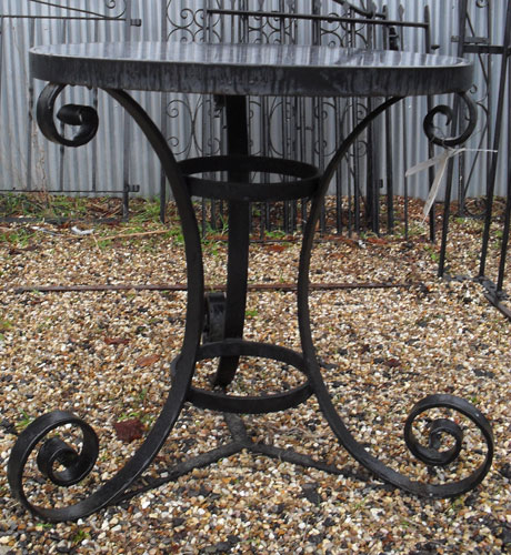 Very heavy duty round table with hand forged legs