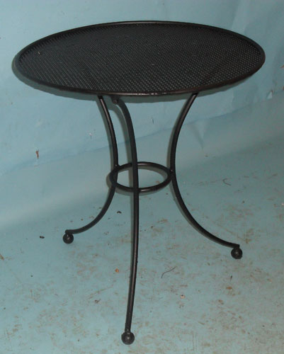 Small round table with perforated top