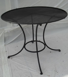 Large round table with perforated top - seats 4